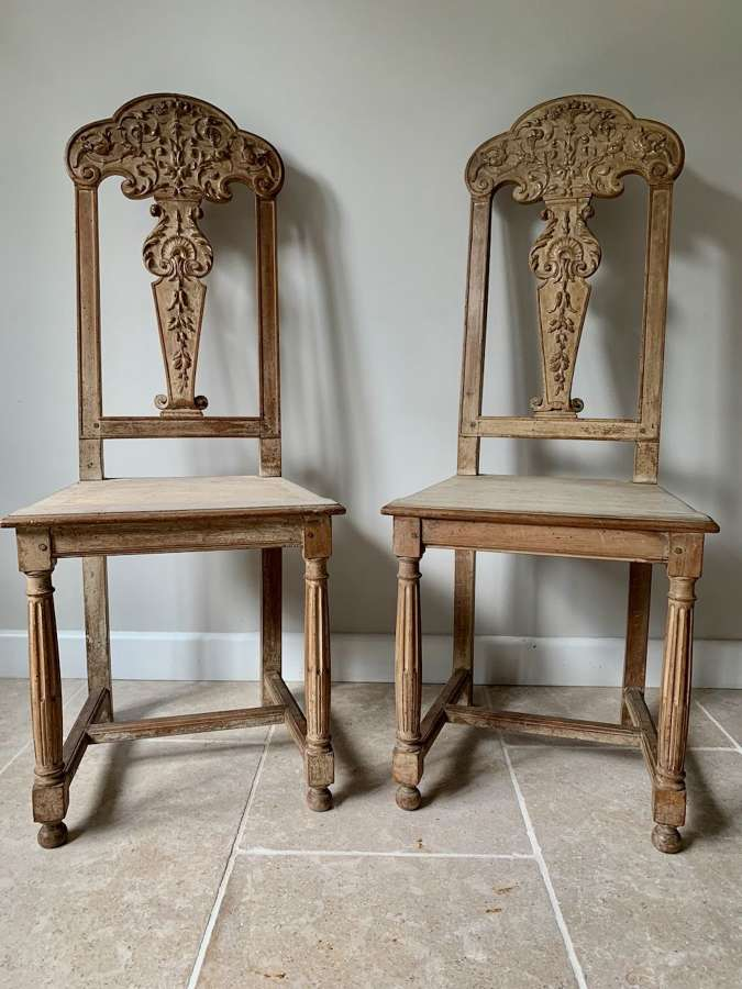 Pair of carved and limed walnut chairs