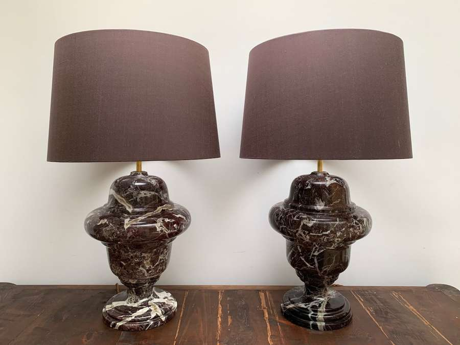 A pair of burgundy marble baluster table lamps