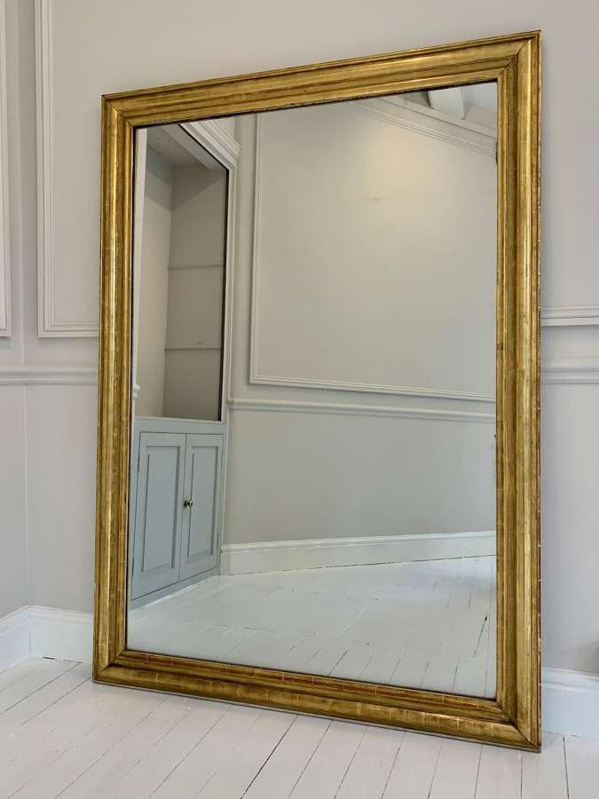 Huge gilt gesso mercury glass mirror