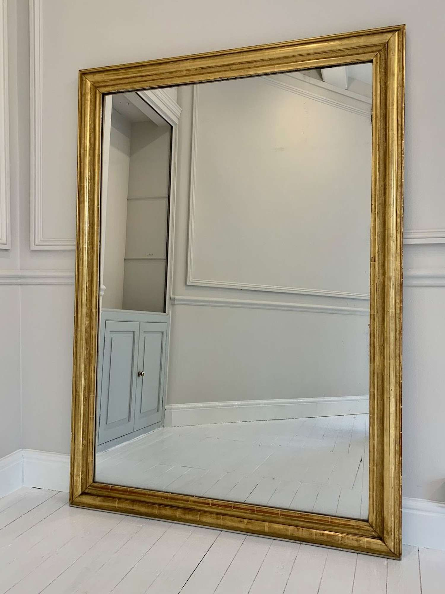 Huge gilt gesso mercury glass mirror