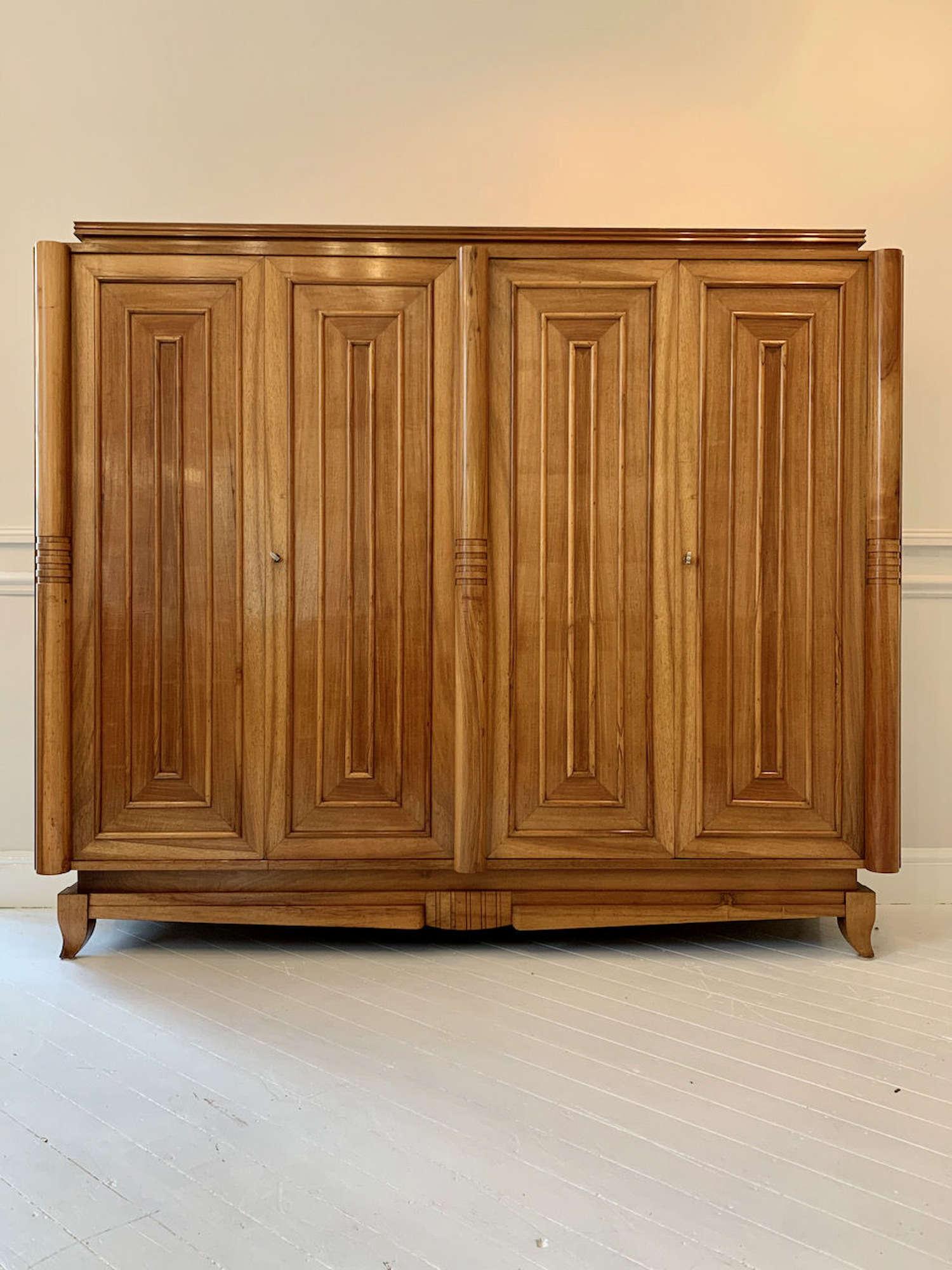 A sculptural Art Deco Walnut cupboard